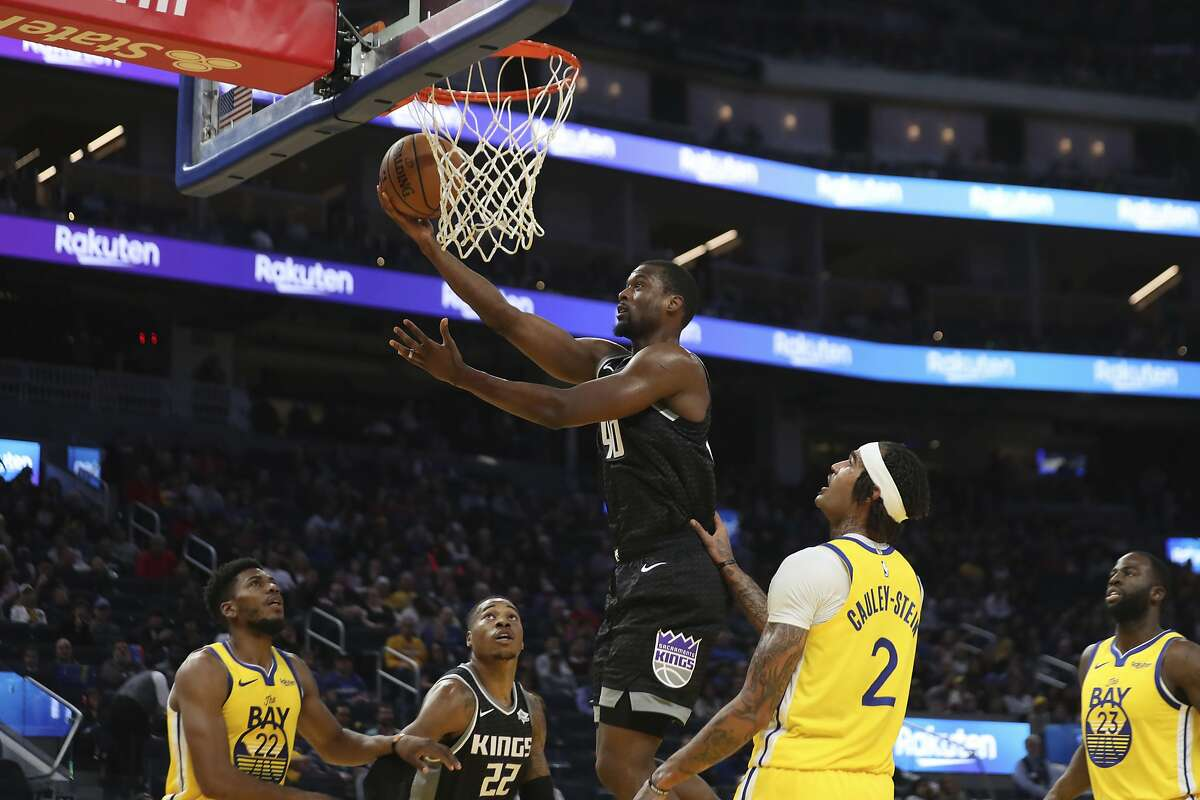 Sacramento Kings forward Harrison Barnes (40) shoots against Golden State Warriors center Willie Cauley-Stein (2) during the first half of an NBA basketball game in San Francisco, Sunday, Dec. 15, 2019. (AP Photo/Jed Jacobsohn)