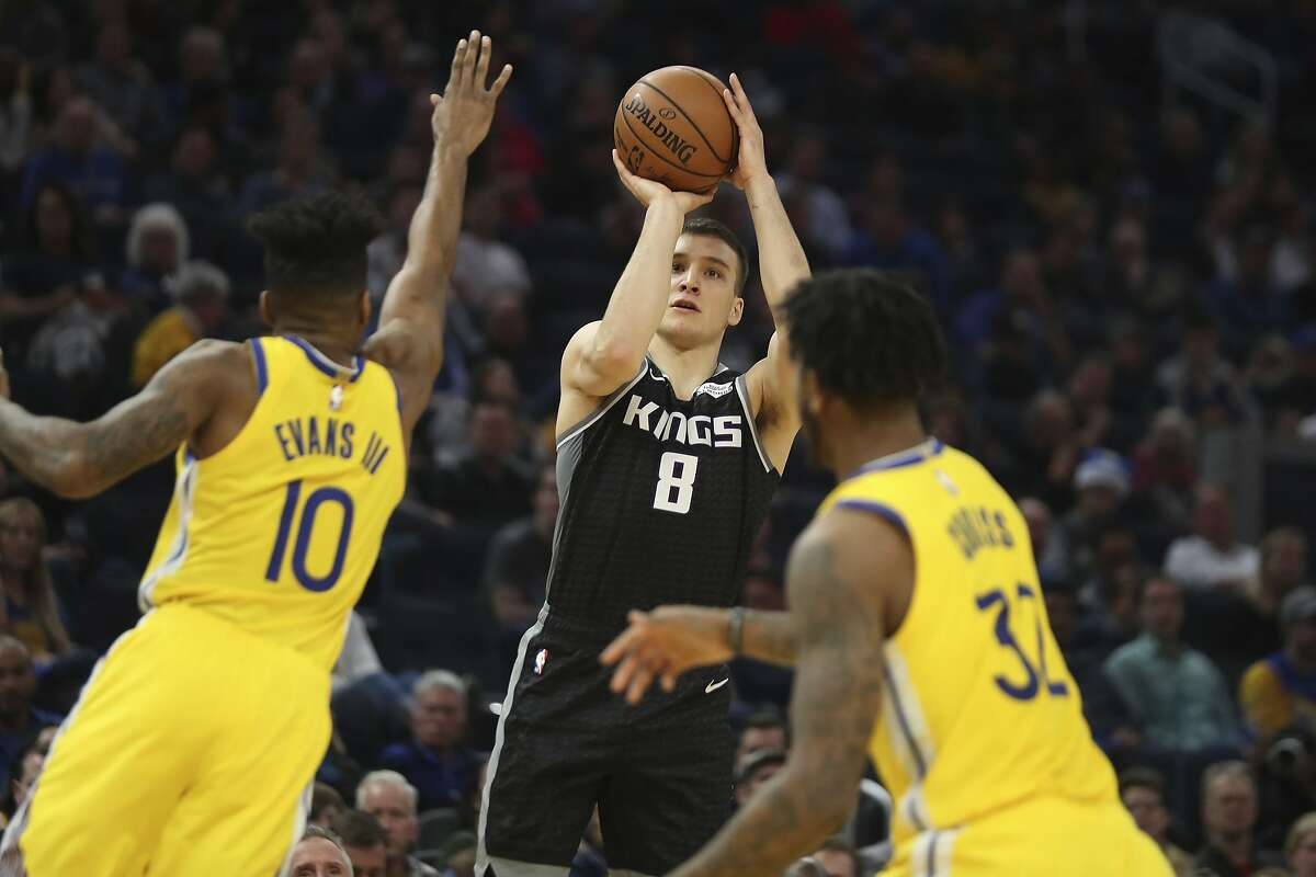 Sacramento Kings guard Bogdan Bogdanovic (8) shoots against Golden State Warriors guard Jacob Evans (10) during the first half of an NBA basketball game in San Francisco, Sunday, Dec. 15, 2019. (AP Photo/Jed Jacobsohn)