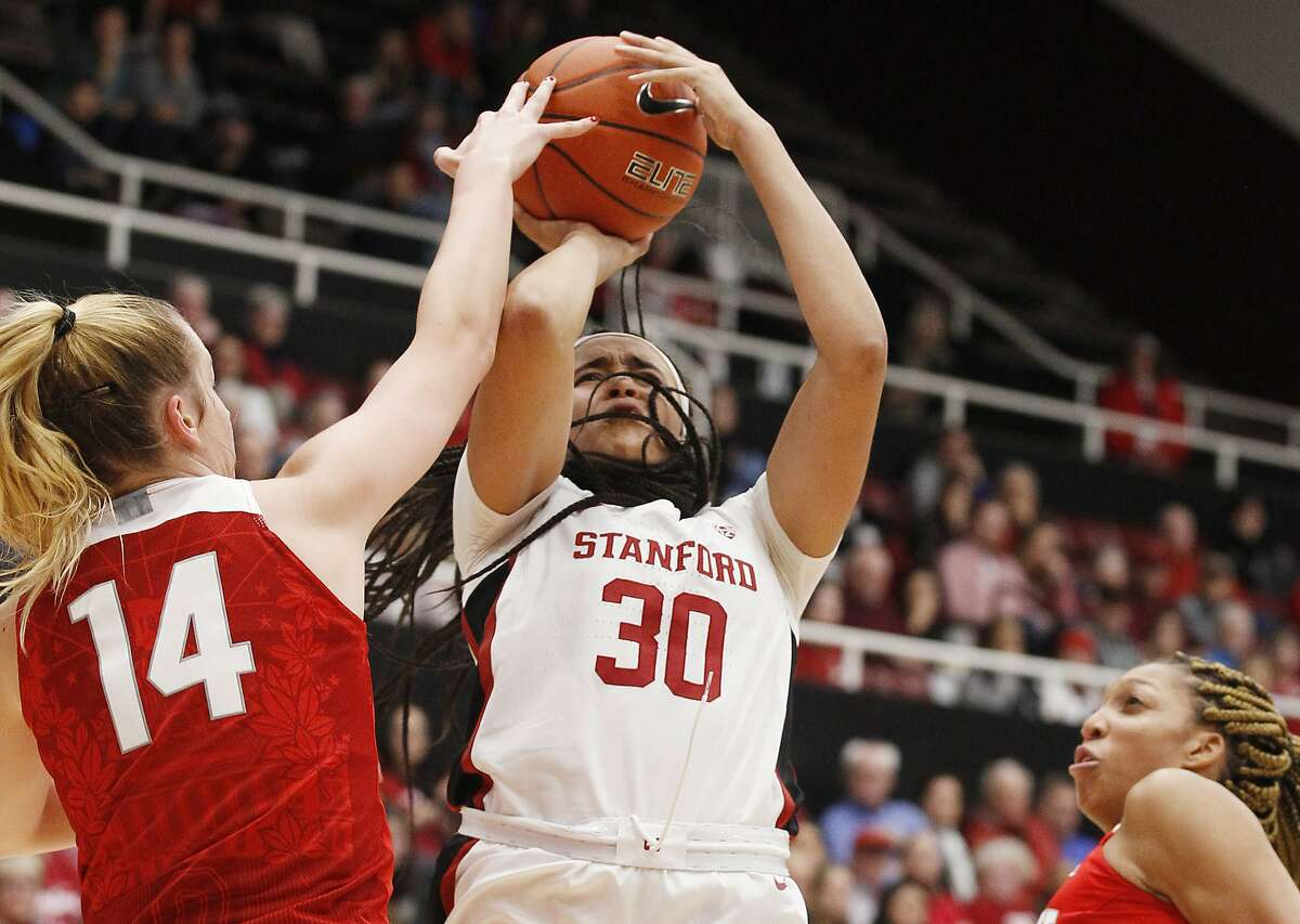 Stanford's Haley Jones (30) shoots as Ohio State's Dorka Juhasz (14) defends during the first half of an NCAA college basketball game, Sunday, Dec. 15, 2019, in Stanford, Calif. Stanford beat Ohio State 71-52. (AP Photo/George Nikitin)