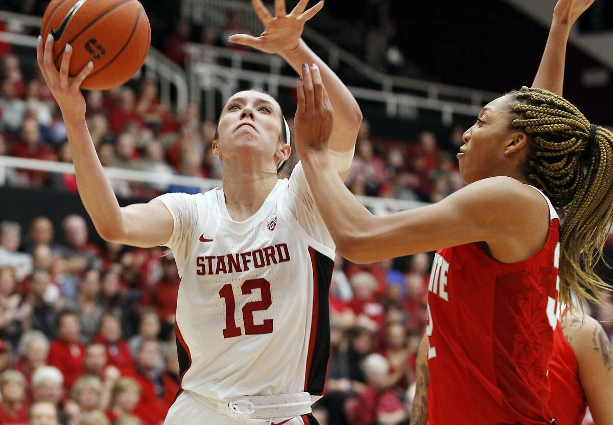 Stanford's Lexie Hull (12) shoots as Ohio State's Aaliyah Patty defends during the first half of an NCAA college basketball game, Sunday, Dec. 15, 2019, in Stanford, Calif. Stanford beat Ohio State 71-52. (AP Photo/George Nikitin)