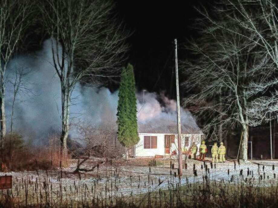 Gladwin County authorities are attempting to contact the property owners of a Billings Township house that burned at about 2 a.m. Friday.(Photo by Tereasa Nims/For the Daily News)