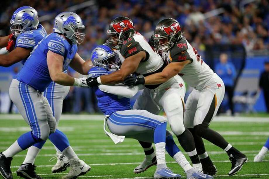 Detroit Lions running back Wes Hills is tackled by Tampa Bay Buccaneers nose tackle Ndamukong Suh (93) and linebacker Carl Nassib during the first half of an NFL football game, Sunday, Dec. 15, 2019, in Detroit. (AP Photo/Paul Sancya) / Copyright 2019 The Associated Press. All rights reserved.