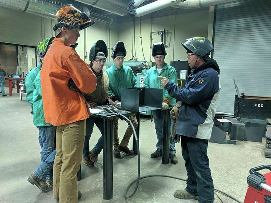 Mid Michigan College welding students recently spent a day learning from Dave Pumford, lead welding supervisor and inspector at Bandit Industries in Remus.(Photo provided)