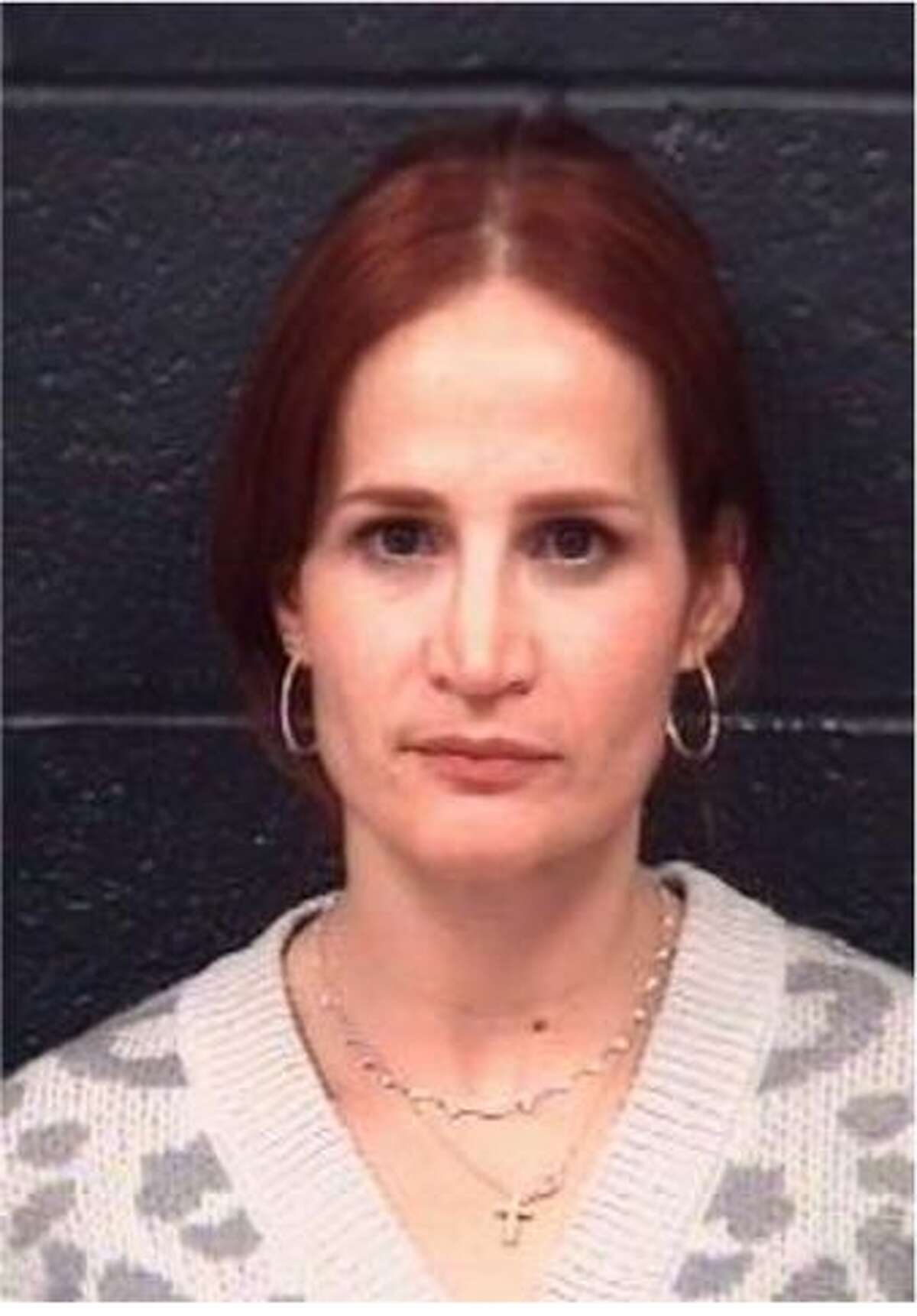 Martha Veronica Riddle was charged with driving while intoxicated.