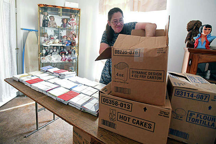 Bradley resident Connie Wietrzykowski counts the 4,600 Christmas cards she wrote for troops in 2018. For her effort, Wietrzykowski, a 20-year employee at the Bradley McDonald's, relies on qualifying card donations and housework help from her husband, Tom Vince, who served in the National Guard for 20 years. This year she completed 7,600 cards. Photo: Tiffany Blanchette | Daily Journal (AP)