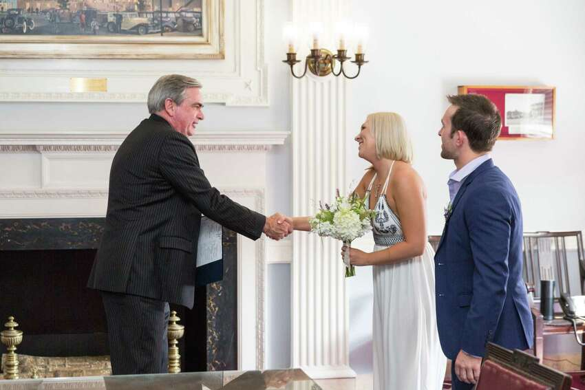 Scenes from Melissa and Nick Kossor's elopement in Schenectady City Hall. They were married by Mayor Gary McCarthy. (Photo by Kristen Renee Photography)