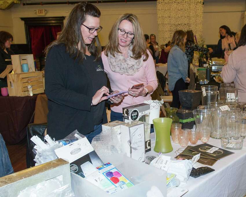 Maria Savino looks at wares presented by Sarah Fichtman, of Bisou Weddings and Events, during a wedding market at the Takk House in Troy on Sunday, March 31, 2019. (Jim Franco/Special to the Times Union)