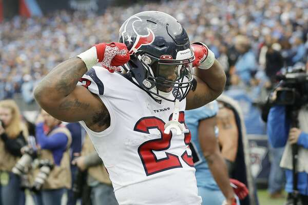 Houston Texans running back Carlos Hyde celebrates after scoring a touchdown against the Tennessee Titans in the second half of an NFL football game Sunday, Dec. 15, 2019, in Nashville, Tenn. (AP Photo/James Kenney)
