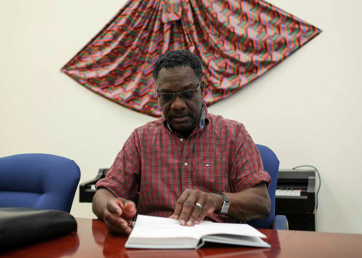 Malcolm Barrett reads a book about his family's history on Monday, Sept. 23, 2019, in Barrett, Texas. Malcolm Barrett is the great-grandson of Harrison Barrett, the founder and first settler of Barrett Station. The elder Barrett was a former slave, believed to be from Louisiana, who bought land east of the San Jacinto River and started a community. Malcolm Barrett said the town was a place the settlers could establish their own identity and their own visions, things denied them during slavery. He is dedicated to preserving the history of the town, even as demographic shifts have brought change to the area.
