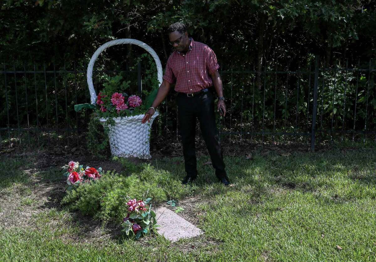 Malcolm Barrett points to the grave of Harrison Barrett, his great-grandfather, in a family cemetery on Monday, Sept. 23, 2019, in Barrett, Texas. Malcolm Barrett is the great-grandson of Harrison Barrett, the founder and first settler of Barrett Station. The elder Barrett was a former slave, believed to be from Louisiana, who bought land east of the San Jacinto River and started a community. Malcolm Barrett said the town was a place the settlers could establish their own identity and their own visions, things denied them during slavery. He is dedicated to preserving the history of the town, even as demographic shifts have brought change to the area.