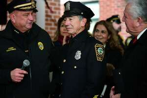 Police officers city officials and local residents greet Officer Cesar Ramirez, a 32-year member of the force, as he is given a sendoff Friday, December 13, 2019, at Norwalk Police Headquarters in Norwalk, Conn. Ramirez was recently diagnosed with brain cancer and is retiring.