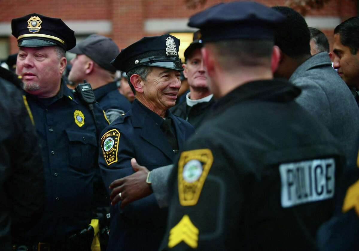 File photo: Police officers city officials and local residents greet Officer Cesar Ramirez, a 32-year member of the force, as he is given a sendoff Friday, December 13, 2019, at Norwalk Police Headquarters in Norwalk, Conn.
