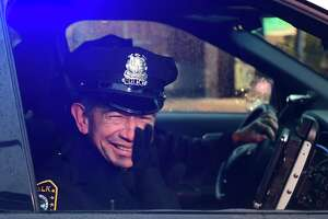 File photo: Norwalk Police Officer Cesar Ramirez, a 32-year member of the force, as he is given a sendoff Friday, December 13, 2019, at Norwalk Police Headquarters in Norwalk, Conn.