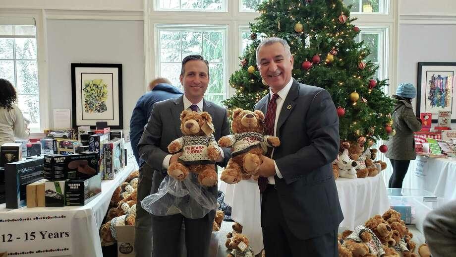 State Senate Majority Leader Bob Duff with State Sen. Carlo Leone at P2P's holiday toy store. Photo: Sandra Diamond Fox / / Connecticut Post
