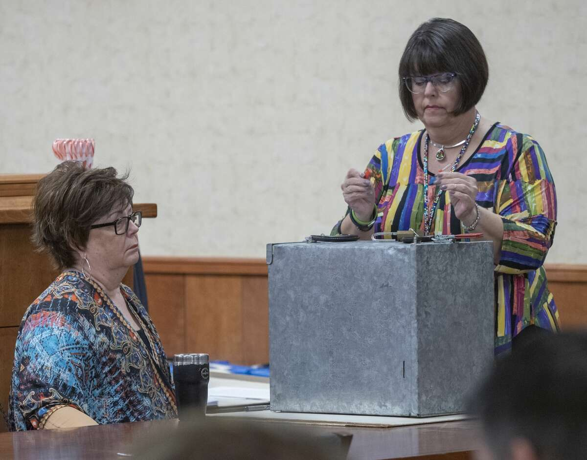 Election officials Carolyn Graves, and Debra Land open the recently found ballot box 12/16/19 morning to discover ballots from the November election. Tim Fischer/Reporter-Telegram