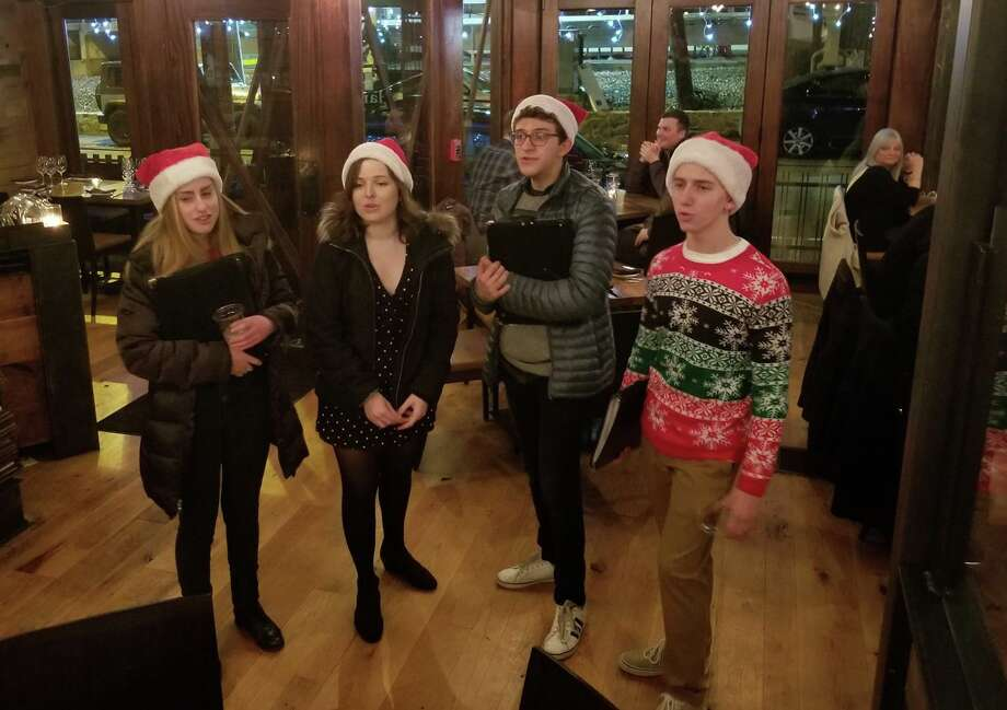 The Westport Weston Chamber of Commerce is once again sponsoring the annual Saugatuck Caroling Crawl to entertain patrons at all local member restaurants on Dec. 21. Pictured are carolers performing at last year's event. Photo: WWCC / Contributed Photo