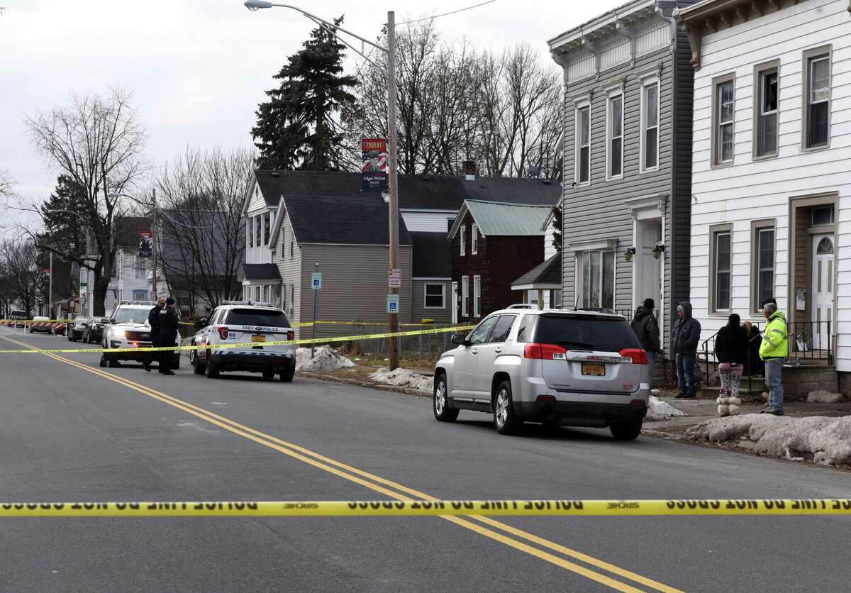 Troy Police investigate the scene on Fifth Avenue between 119th and 120th streets where a woman was shot dead and a man tried to kill himself on Monday, Dec. 16, 2019, in Troy, N.Y. (Will Waldron/Times Union)