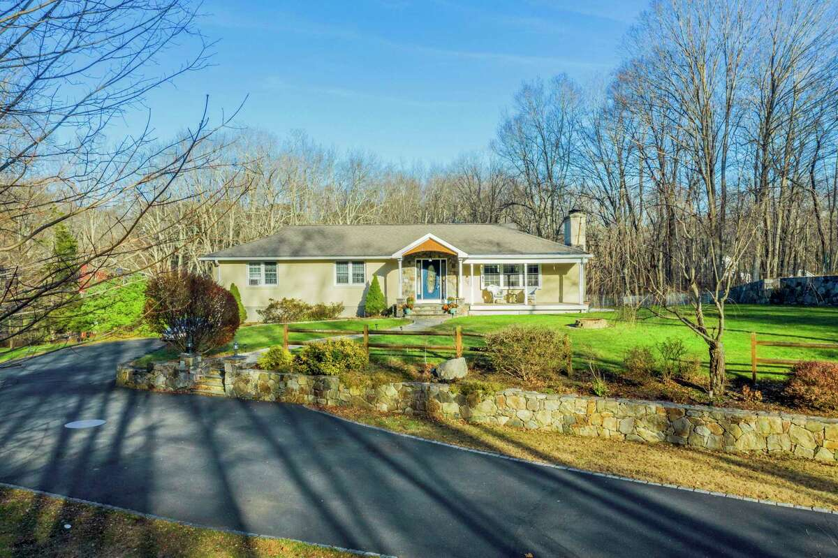 The beige stucco and stone ranch house at 930 Black Rock Turnpike at 930 Black Rock Turnpike sits on a three-acre property in a quiet lightely wooded setting.