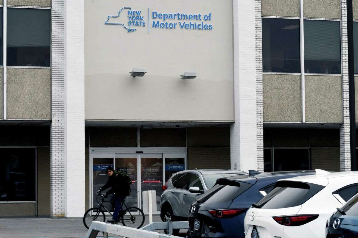 Exterior of the Albany County Department of Motor Vehicles office on the first day of the new Green Light law on Monday, Dec. 16, 2019, in Albany, N.Y. The new law allows all New Yorkers, regardless of their citizenship or lawful status in the United States, age 16 and older to apply for a standard, not for federal purpose, non-commercial driver license or learner permit. (Will Waldron/Times Union)