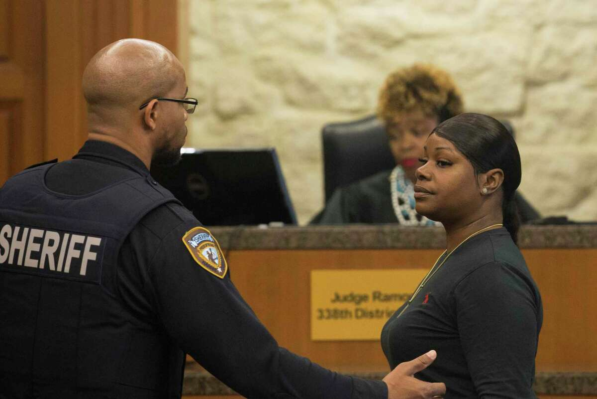 Tiffany Henderson appears before Judge Ramona Franklin at Harris County 338th District Criminal Court on Monday, Dec. 16, 2019, in Houston. Henderson, 37, was later taken into custody after the judge raised her bond. She was charged with hindering the apprehension of her son, Tavores Henderson, for allegedly taking her son to a hotel to hide from police officers after he fled a crime scene where Nassau Bay Police Sgt. Kaila Sullivan died. Geoffrey Wheeler, 33, her boyfriend was also facing charges of hindering apprehension in the case, and was also taken into custody after Franklin raised his initial bond.