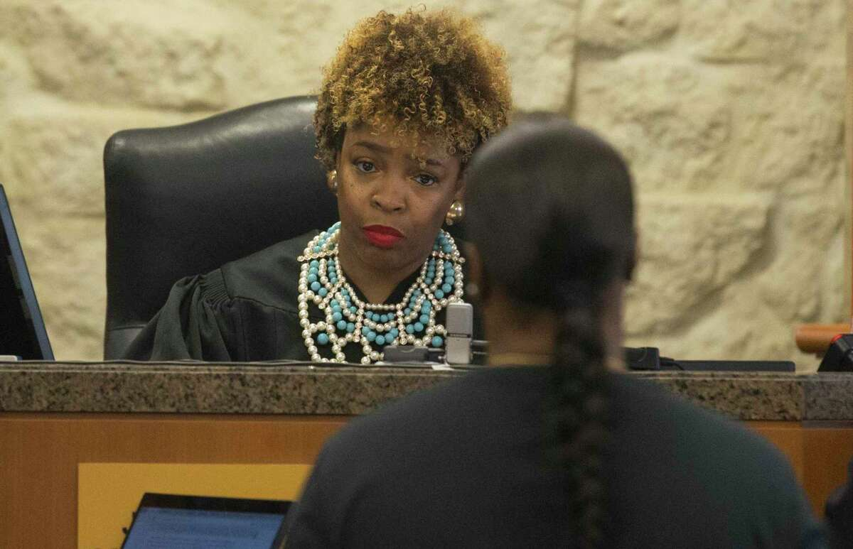 Judge Ramona Franklin at Harris County 338th District Criminal Court hears Tiffany Henderson's case on Monday, Dec. 16, 2019, in Houston. Henderson, 37, was later taken into custody after the judge raised her initial bond. She was charged with hindering the apprehension of her son, Tavores Henderson, for allegedly taking her son to a hotel to hide from police officers after he fled a crime scene where Nassau Bay Police Sgt. Kaila Sullivan died. Geoffrey Wheeler, 33, her boyfriend was also facing charges of hindering apprehension in the case, and was also taken into custody after the Franklin raised his initial bond.