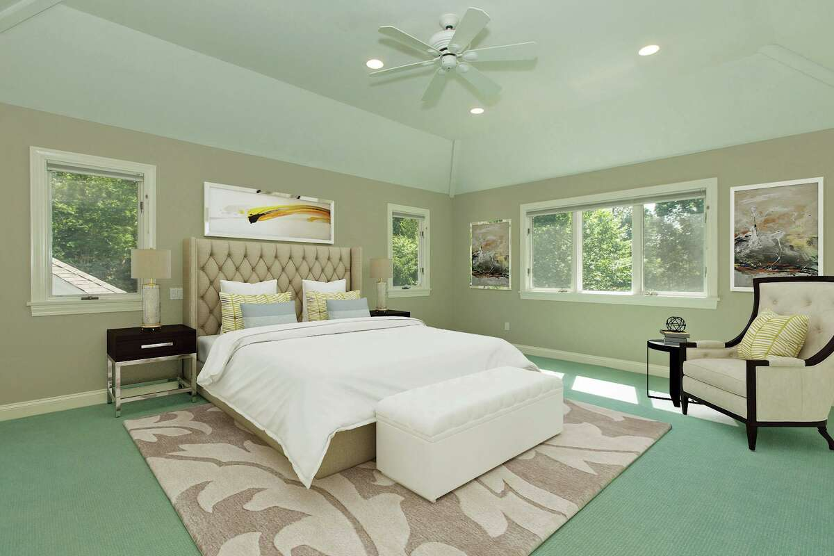 Four of this home's six bedrooms are found on the second floor including the master suite. (virtually staged photo)