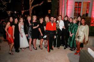 EMBARGOED FOR SOCIETY REPORTER UNTIL DEC. 20  Fady Armanious, center, with friends at Legacy Community Health party honoring him on December 12, 2019.