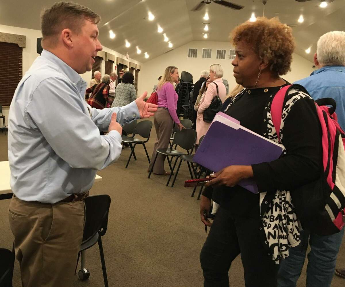Janice Little, a water customer of Harris County Municipal Utility District 120, talks with Eric Hansen, president of the West Harris County Regional Water Authority after the authority's Dec. 11 meeting.