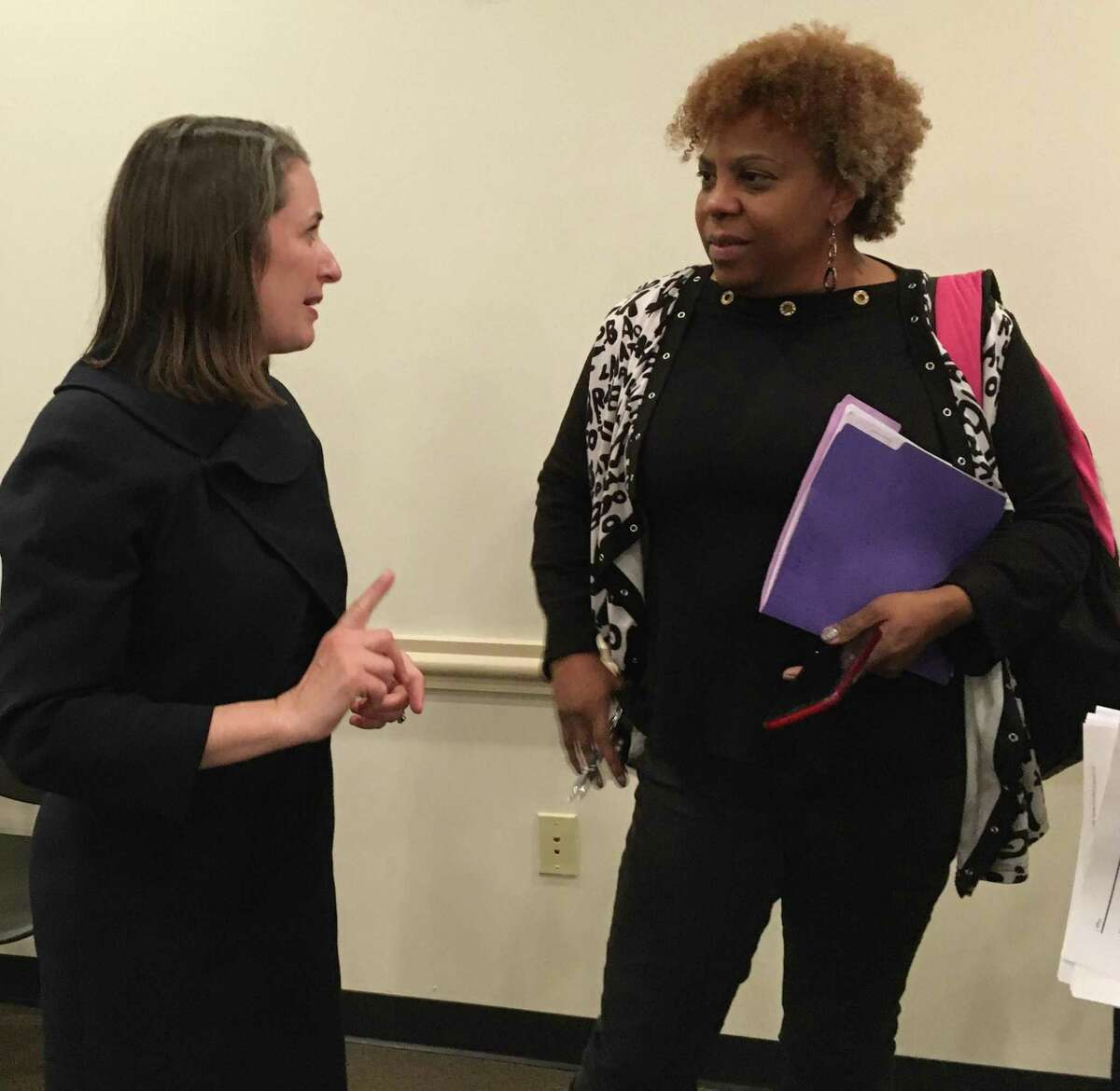 Alia Vinson, left, legal counsel for the West Harris County Regional Water Authority, speaks with Dr. Janice Little after the authority's Dec. 11 meeting. Little said she didn't use the 42,000 gallons billed by her MUD in July. Vinson said she would investigate the situation and get back with Little.