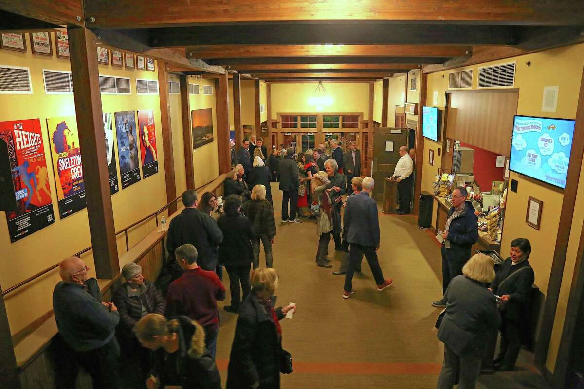 People mingle in the lobby at the Westport Country Playhouse's