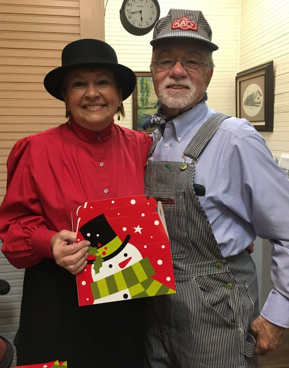 Katy Heritage Society members Marilyn and David Frishman provided boxes at the Katy Depot for people to fill with cookies as they participated in the first annual Christmas Heritage Tour and Cookie Walk on Dec 5.