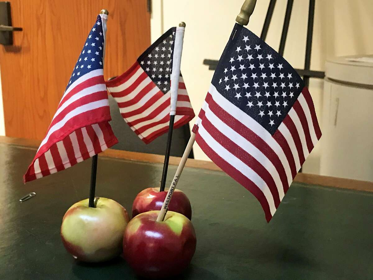 Three apples with the American flag outside the auditorium in town hall on Veterans Day. Taken Nov. 11, 2019 in Westport, Conn.