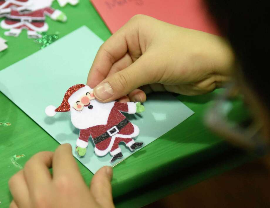 The RAC Junior members will wrap your gifts for a cash donation on Dec. 21 from noon to 5 p.m. at the Rowayton Arts Center, 145 Rowayton Avenue, Rowayton. For more information, visit rowaytonarts.org. Photo: Tyler Sizemore / Hearst Connecticut Media / Greenwich Time