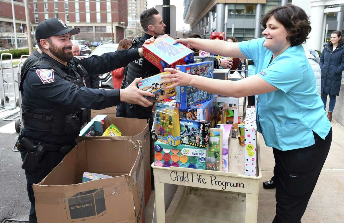 Brookfield Police Department Officer Joe Kyek (left) hands toys to Childlife Specialist Kacey Gornley outside of Yale New Haven Children's Hospital on December 16, 2019. Brookfield Police Department Stuff a Cruiser Dec. 12 from 10 am to 4 p.m. Collecting puzzles, lego kits, board games, action figures/dolls, headphones, gift cards Drop-off location: 84 Federal Road, Brookfield (parking lot next to Five Guys and Kohl's) Find out more Easton Police Department Stuff a Cruiser Dec. 5 between 8 a.m. and 12 p.m. Drop-off location: Easton Public Library Parking Lot, 691 Morehouse Road Find out more