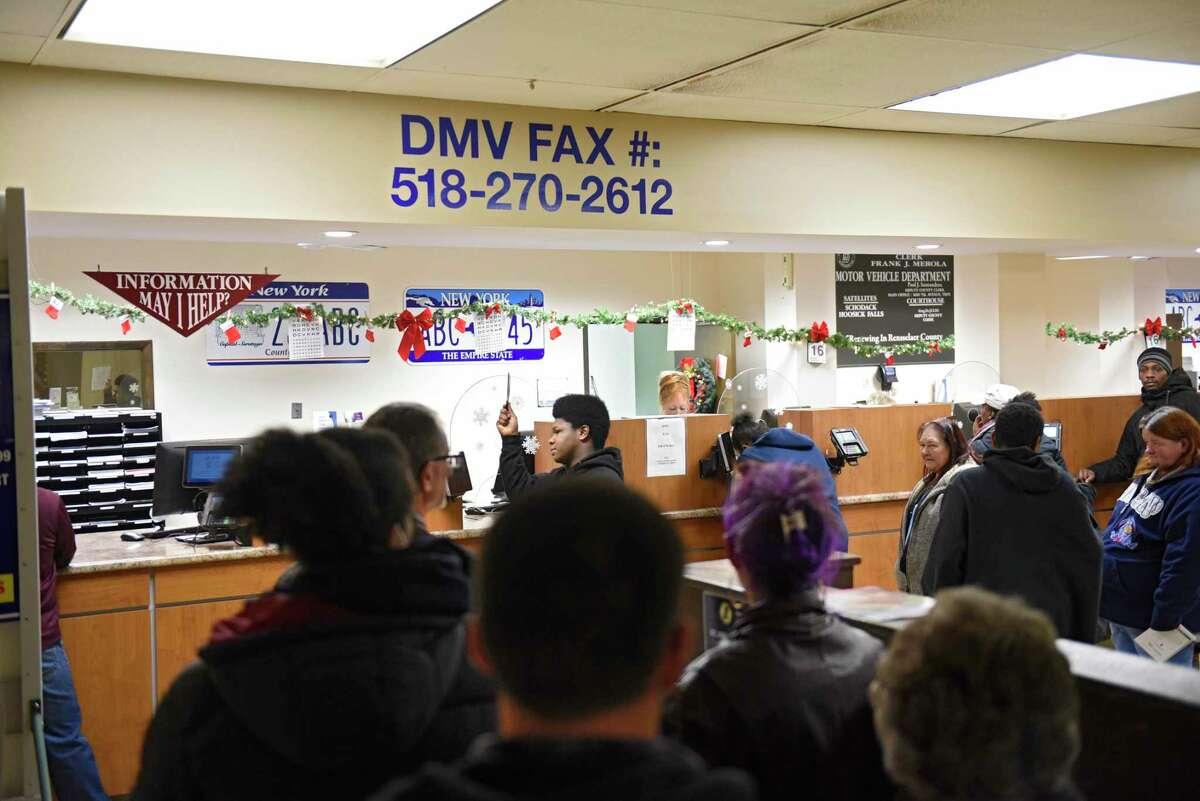 People wait in line at the Rensselaer County Department of Motor Vehicles on Monday, Dec. 16, 2019 in Troy, N.Y. (Lori Van Buren/Times Union)