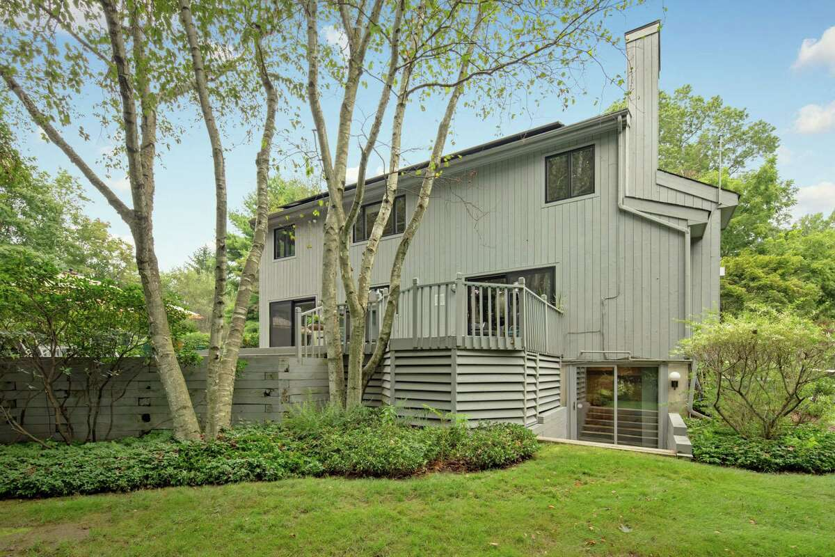 The lightly wooded property is nicely landscaped to enhance its appearance and privacy.