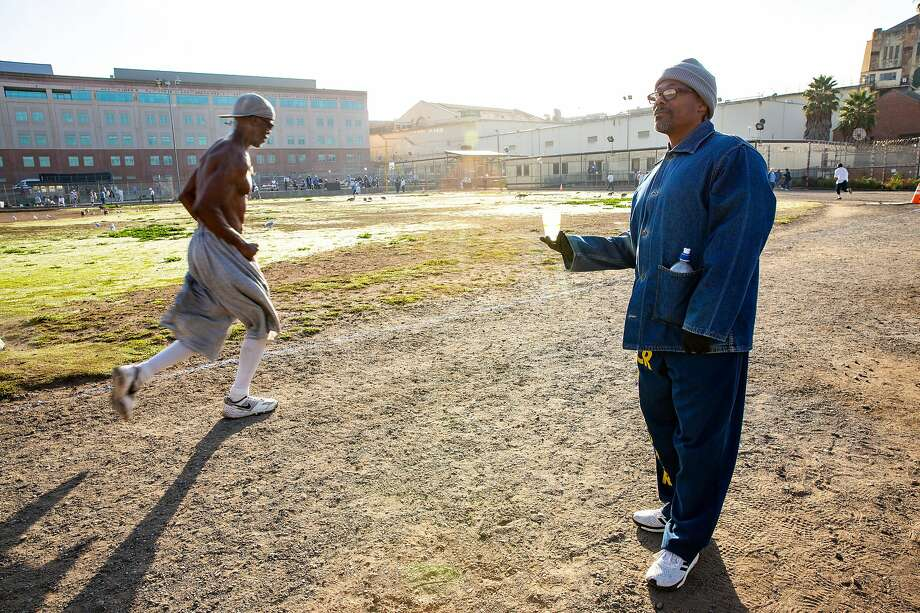 Clifton Williams hands out waters as Wallace Jackson completes another lap around the prison yard in the San Quentin State Prison marathon on Friday, Nov. 22, 2019, in San Quentin, Calif. Photo: Santiago Mejia / The Chronicle