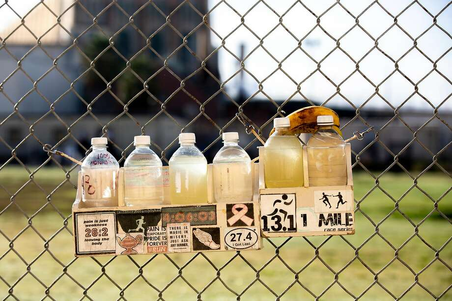 Water bottles are left on the yard for participants in the San Quentin State Prison marathon on Friday, Nov. 22, 2019, in San Quentin, Calif. Photo: Santiago Mejia / The Chronicle