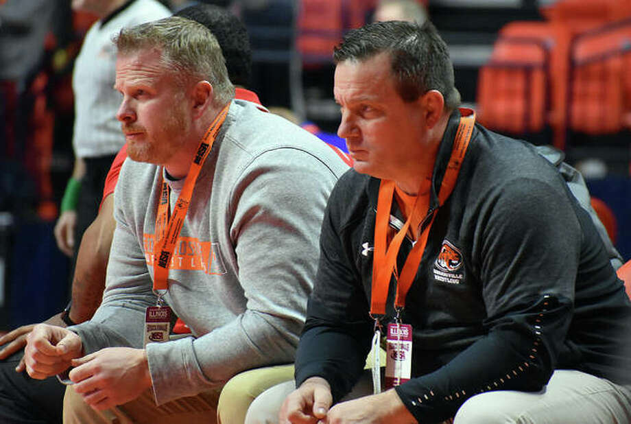 Edwardsville wrestling head coach Jon Wagner, right, and assistant coach Doug Heinz watch intently as Lloyd Reynolds wrestles in a consolation match at last year's Class 3A state tournament in Champaign. Photo: Matt Kamp | For The Telegraph