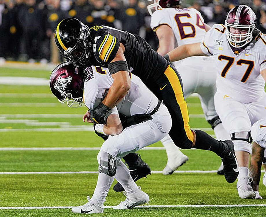 Iowa defensive end AJ Epenesa sacks Minnesota quarterback Tanner Morgan during a regular-season game in Iowa City, Iowa. Iowa won 23-19. Photo: Rick Brewer For The Intelligencer