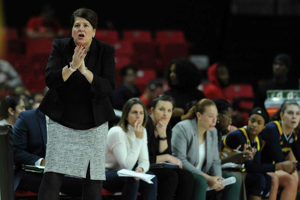 Quinnipiac head coach Tricia Fabbri instructs her team during the second half of an NCAA college basketball game against Maryland on Sunday, Nov. 24, 2019, in College Park, Md. Maryland won 107-52. (AP Photo/Gail Burton)