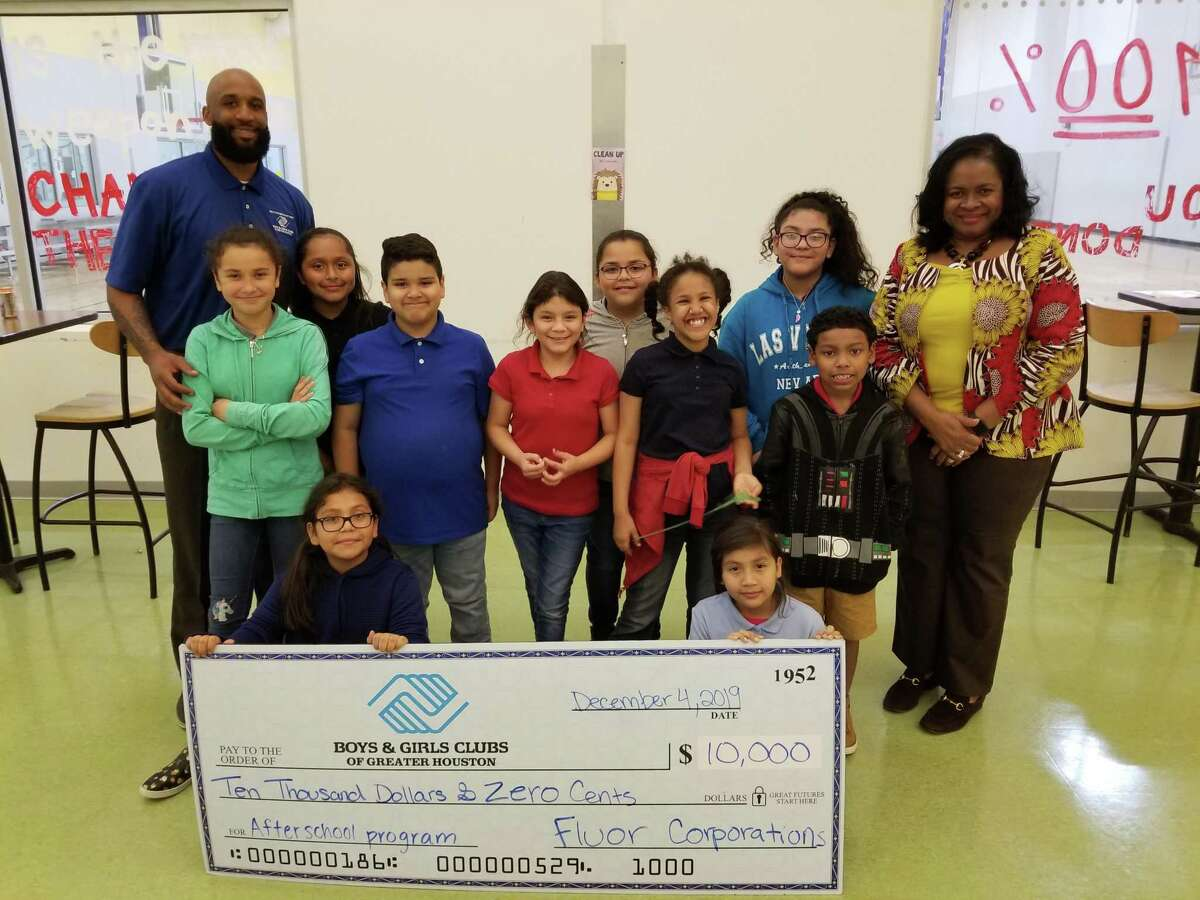 Boys & Girls Clubs of Greater Houston's Richmond Rosenberg Club in Fort Bend County received a check for $10,000 from Sugar Land-based Fluor Corporation. Presenting the check and then reading to some of the younger Club members, was Barbara Jones, Fluor's Senior Manager, Community & Public Affairs.