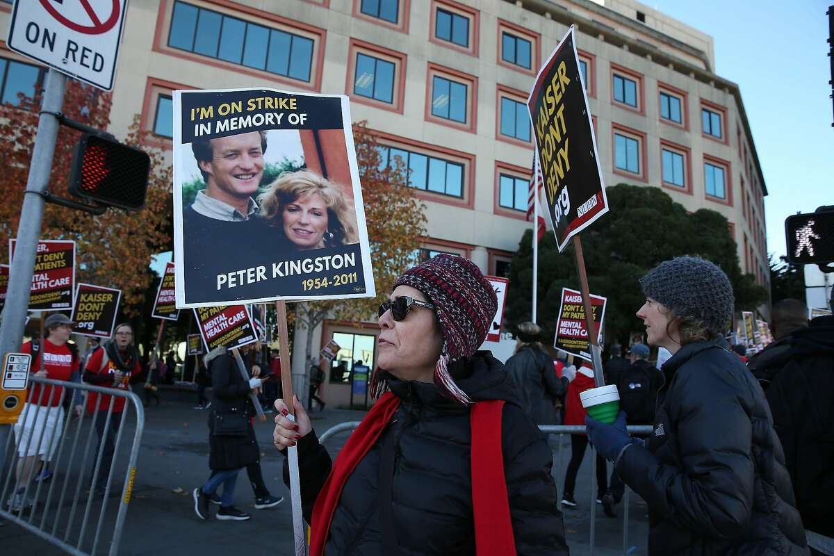 Christine Messinger, Kaiser therapist and bargaining committee member, pickets with other members of the National Union of Healthcare Workers on Geary Boulevard outside Kaiser Permanente San Francisco Medical Center on Monday, December 16, 2019 in San Francisco, Calif.
