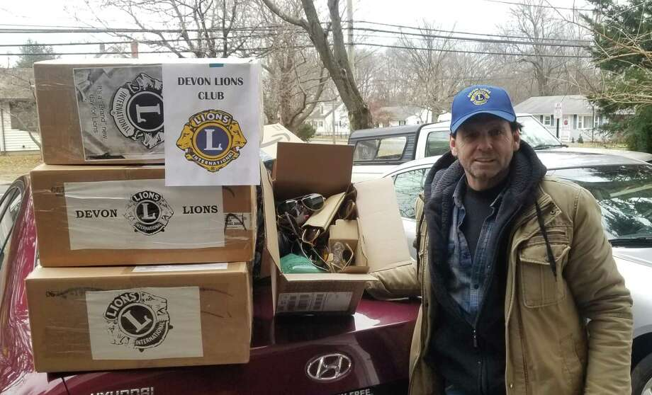 Tom Dowin stands with boxes of eyeglasses to be donated to third world countries. Photo: Contributed Photo