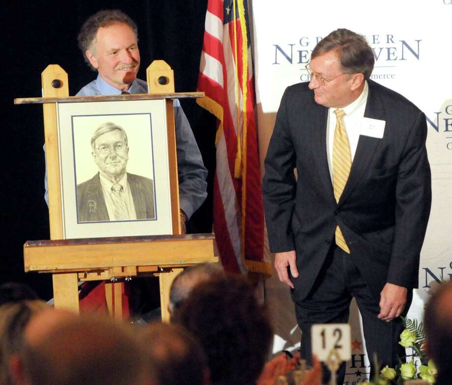 Artist and Greater New Haven Chamber of Commerce member Tony Falcone, left, unveils his portrait of outgoing Chamber of Commerce Chairman Hugh Manke Thursday, April 18, 2013 during the Greater New Haven Chamber of Commerce 219th Annual Meeting a the Omni New haven Hotel at Yale. Photo by Peter Hvizdak /New Haven Register Photo: Peter Hvizdak / New Haven Register / ©Peter Hvizdak /  New Haven Register