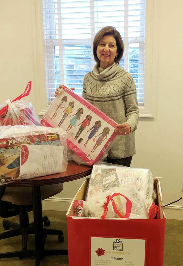 Halstead's Joanne Santulli coordinated Halstead's drive to provide gifts to local kids in need. Photo: Contributed Photo