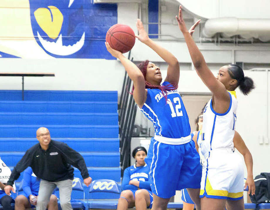 LCCC coach Jaron Young, far left back, watches closely as Kenya Burnett attempts a shot over an Illinois Central College defender. Burnett is a 5-10 sophomore from Alton. Photo: Jan Dona | For The Telegraph