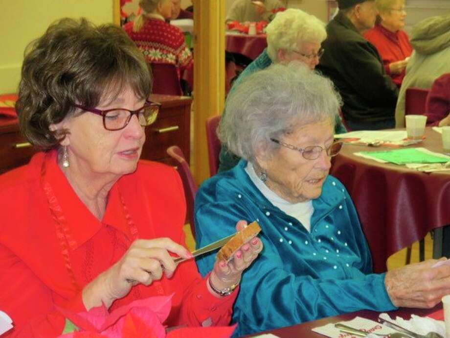 Women enjoy a lunch served by Chippewa Hills administrators. (Courtesy photo)