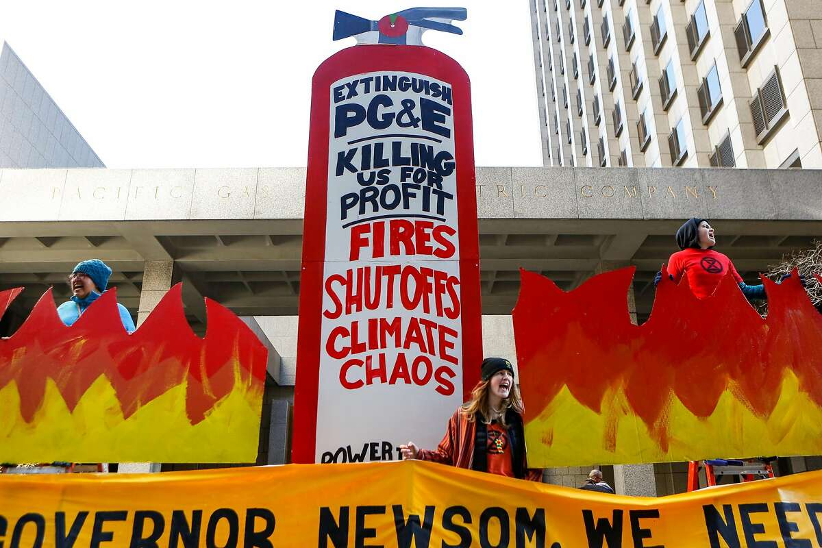 Protesters from the Sunshine Movement block the entrance to PG&E headquarters as other chained themselves to entrance doors on Monday, December 16, 2019 in San Francisco, Calif.