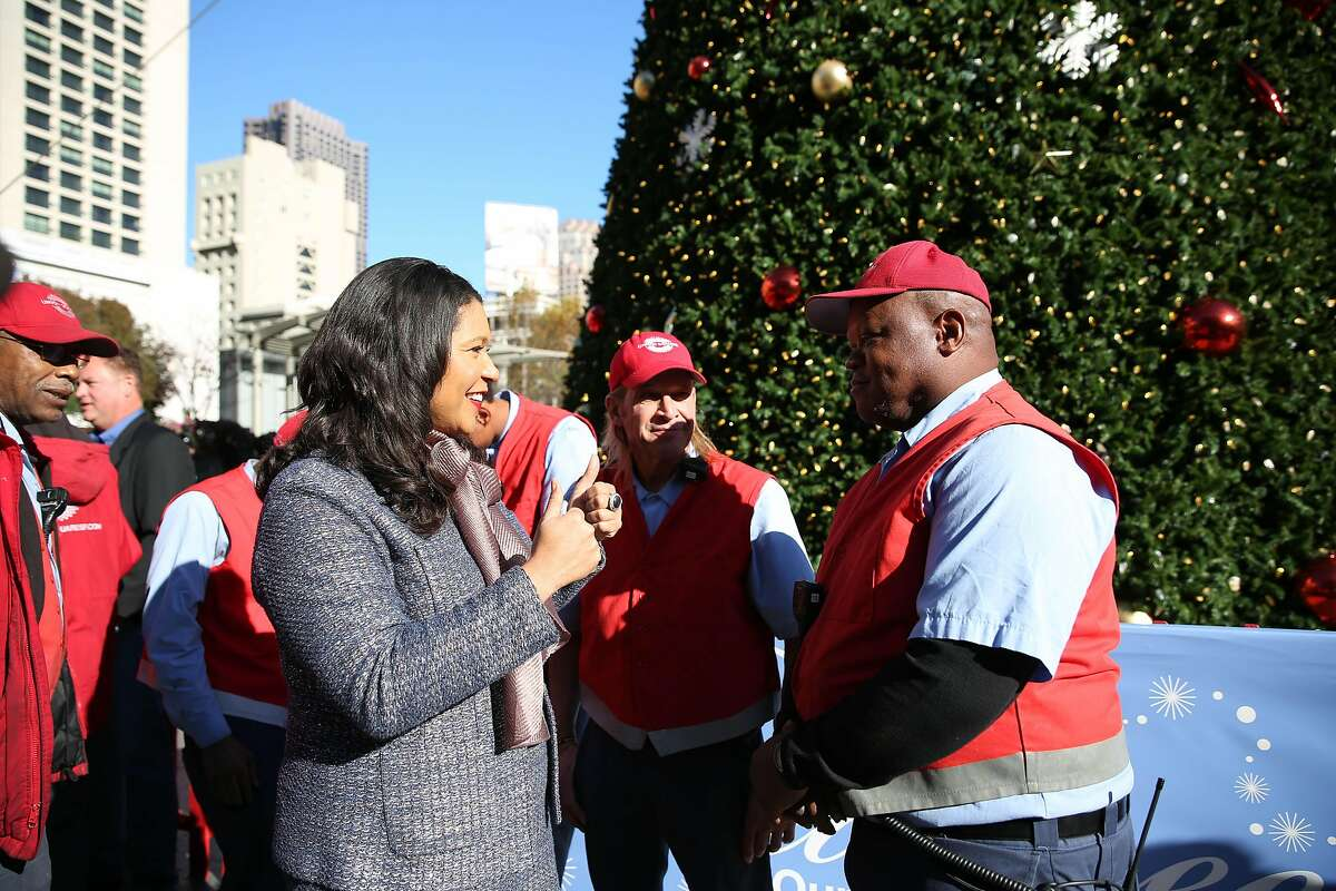 Mayor London Breed (l to r) talks with Michael Chaney, Union Square ambassador after speaking at a press conference at Union Square on Monday, December 16, 2019 in San Francisco, Calif.